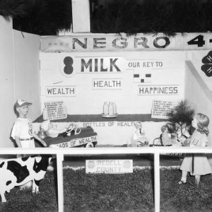 """NC State Fair exhibit booth on African American 4-H Club Division, """"""""Milk -- Our Key to Wealth, Health, Happiness"""""""