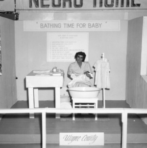 """NC State Fair exhibit booth on African American Home Demonstration """"Bathing Time for Baby"""""""