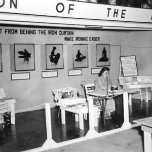 """NC State Fair exhibit booth on """"Get Out from Behind the Iron Curtain, Make Ironing Easier"""""""