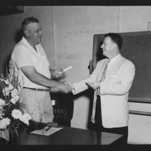 E. Y. Floyd giving ASC Award to to H. D. Godfrey at Magnum Hall, August 1954