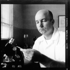 Dr. J. N. Sasser at work in lab