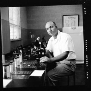 Dr. J. N. Sasser at work in lab