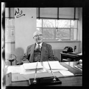 Dean J. Harold Lampe at desk