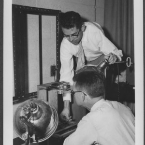 Dr. Clayton and Dr. Morrow with microscope