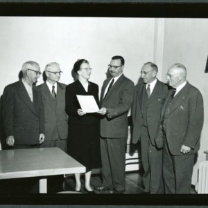 D. S. Weaver presenting distinguished service certificate to Mrs. Gertrude Weaver
