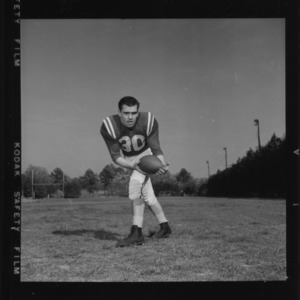Action shot of football player Arnold Nelson