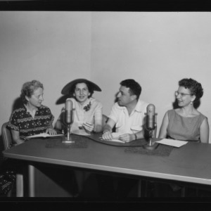 Farm and Home Week; Ted Hyman during radio program with new Farm and Home President, Mrs. Moffitt, and two others