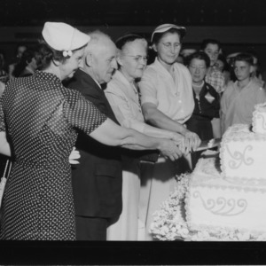 400 pound cake at International Tea during Farm and Home Week