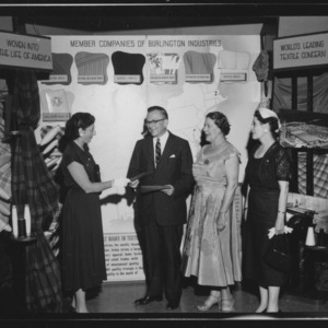 Farm and Home Week; United States Treasury Bond Award's Group in front of Burlington Industries Exhibit at Coliseum