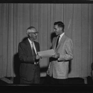 I. O. Schaub presenting the Schaub Award to William Hal Johnson during Farm and Home Week