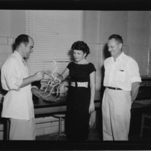 Dr. Henry W. Garren and others with poultry skeleton during Poultry Science Week