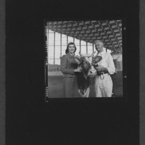 N. C. State Fair: American dairy princess Shari Lewis with grand champion female Gurney