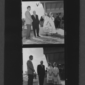 J. W. Pou, L. Y. Ballentine, and costumed dairy maids at the dedication of the Dairy Box during the NC State Fair