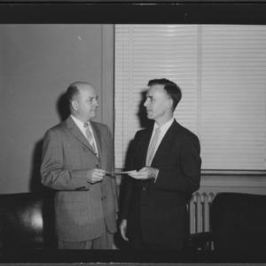 J. N. Neuse handing check for Winn-Dixie Scholarship to L. B. Rogers