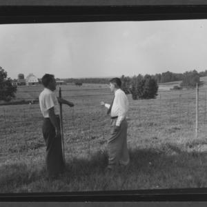 Manuel Curbelo and Dr. D. S. Chamblee examining farm