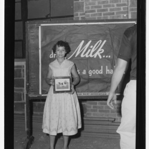 Girl participating in African American dairy competition, 1957