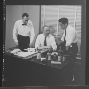 Dr. William C. Bell and others with ceramic specimens
