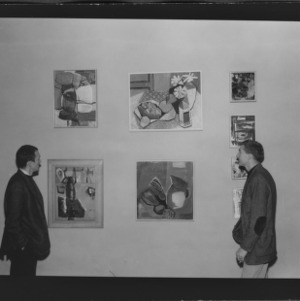 Wayne Taylor (left) and John Peterson, School of Design Students, Looking at Paintings to be auctioned off, College Union