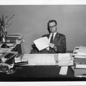 Jimmy Erdall at Desk in College Union