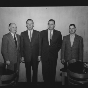 L. R. Harrill, William Poe, D. S. Weaver, and W. R. Franks attending Tractor Maintenance Banquet