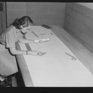 Doris Lee Garcia, first woman to receive a bachelor's in industrial engineering, at drafting table