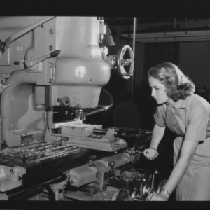 Doris Lee Garcia, first woman to receive a bachelor's in industrial engineering, and other working machinery in lab