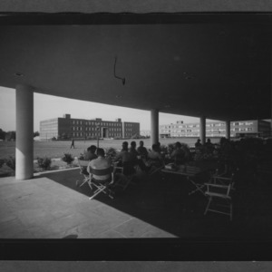 Campus: Williams and Gardner Halls seen from College Union Terrace, Students at tables in foreground