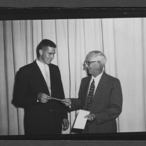 Dean I. O. Schaub presenting award to student